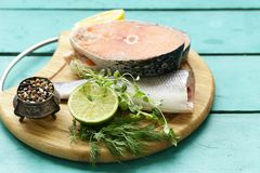 Raw fish sea bass and salmon. With lemon and herbs Stock Photo