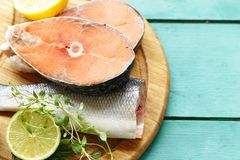 Raw fish sea bass and salmon. With lemon and herbs Royalty Free Stock Photo