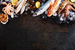Raw Fish and Seafood Chilling on Ice on Wood Table Royalty Free Stock Image