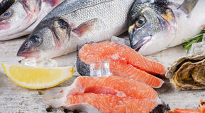 Raw fish and seafood with fresh aromatic herbs. And spices. Healthy diet eating Stock Photo