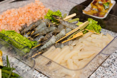 Raw Fish and Seafood in Tray at Buffet Grill Stock Photos