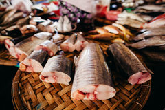 Raw fish sliced and cut at street market. Raw fish assorted sliced and cut at street local market in Asia, Vietnam Royalty Free Stock Photos