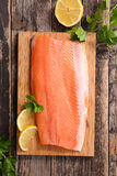 Raw fish,trout fillet. On board Royalty Free Stock Images