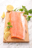 Raw fish,trout fillet. On board Royalty Free Stock Photos