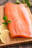 Raw fish,trout fillet. On board Stock Photography