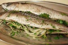 Raw fish tucked onions Stock Photo