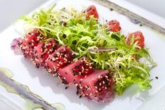 Raw fish tuna with salad. Frieze Royalty Free Stock Image
