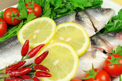 Raw fish with vegetables Stock Photo