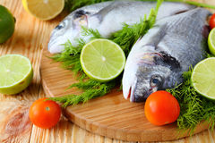 Raw fish and vegetables Royalty Free Stock Photos
