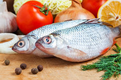 Raw fish and vegetables Stock Image