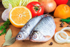 Raw fish and vegetables Royalty Free Stock Images