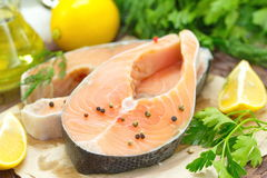 Raw fish with vegetables, lemon and oil prepared for cooking. Raw fish with vegetables, lemon, spices and oil prepared for cooking Royalty Free Stock Photography