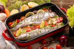 Raw fish with vegetables in a pan ready to bake.  Royalty Free Stock Images