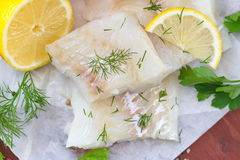 Raw fish on the wooden table Stock Photography