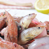 Raw fishes. Closeup of a plate with raw fishes ready to be cooked Stock Photo