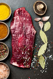 Raw flank steak on stone background Stock Photos