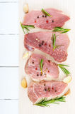 Raw flat meat for steak chop with spices on a light background Royalty Free Stock Image