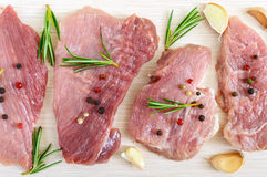 Raw flat meat for steak chop with spices on a light background. Stock Images