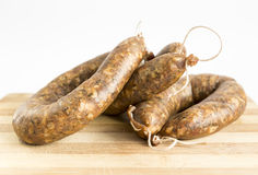 Raw flat sausages Royalty Free Stock Photos