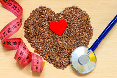 Raw flax seeds heart shaped and stethoscope Stock Image