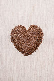 Raw flax seeds linseed heart shaped Stock Photography