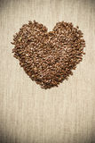 Raw flax seeds linseed heart shaped Royalty Free Stock Photo