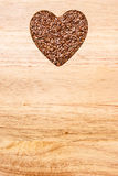 Raw flax seeds linseed heart shaped Royalty Free Stock Photos