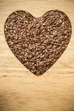 Raw flax seeds linseed heart shaped Stock Image