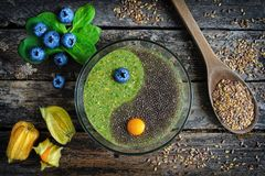 Raw flaxseed porridge with chia stock images