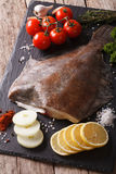 Raw flounder with ingredients on a slate board closeup. Vertical. Raw flounder with ingredients on a slate board on a table closeup. Vertical Royalty Free Stock Photography