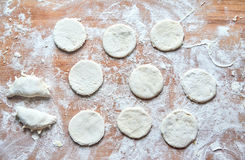 Raw floured dough on wooden table Royalty Free Stock Photos
