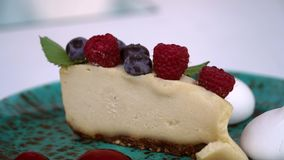 Raw food cheesecake with cashew nut and raspberry. Cheesecake with cashew nut and raspberry stock footage