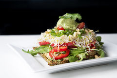 Raw food - cracker with good toppings. Raw cracker with good and healthy raw toppings Stock Images
