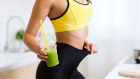 Raw Food Diet. Fit Girl In Oversize Pants stock photography