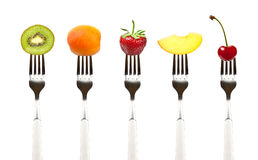 Raw Food. Fruits on forks Stock Image