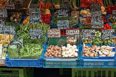 Vegetables, mushrooms and other raw food on the market. Raw food on the market display: scottish peas, green beans, champignons, shiitake mushrooms, oyster stock image