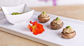 Raw food mushrooms with filling Royalty Free Stock Photography