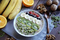 Raw food porridge made of green buckwheat and flaxseeds royalty free stock photos