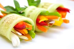 Raw food recipe with cucumber, pepper, onion and carrot Royalty Free Stock Photo