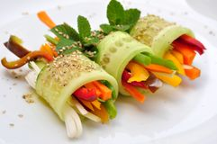 Raw food recipe with cucumber, pepper, onion and carrot Royalty Free Stock Images