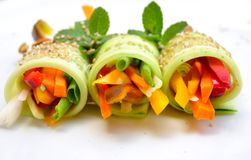 Raw food recipe with cucumber, pepper, onion and carrot Stock Photography