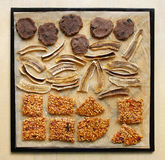 Raw foodism sweets, cookies, banana chips, buckwheat brittles Royalty Free Stock Image
