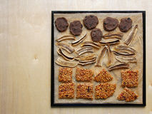 Raw foodism sweets (flax cookies, banana chips, buckwheat brittl Royalty Free Stock Photo