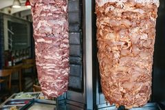Free Raw Foods For Outdoor Shawarma - Two Kinds Of Meat On Vertical Grill On Kitchen Background With Vegetables In Stainless Royalty Free Stock Images - 102349959