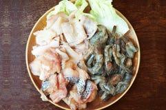 Closeup of Fresh squid, pacific white shrimp and fish. Raw foods: Fresh squid, white leg shrimp or pacific white shrimp Litopenaeus vannamei, formerly Penaeus Royalty Free Stock Photography