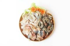 Closeup of Fresh squid, pacific white shrimp and fish. Raw foods: Fresh squid, white leg shrimp or pacific white shrimp Litopenaeus vannamei, formerly Penaeus Royalty Free Stock Photos
