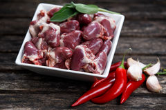 Raw Free range Duck hearts in squared plate Royalty Free Stock Photography