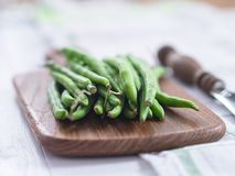 Raw French beans. On a tablet Stock Images