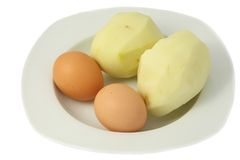 Raw french fries and eggs Stock Image