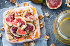 Raw French soft cheese from Brittany region covered with chopped figs, walnuts and honey Royalty Free Stock Photo